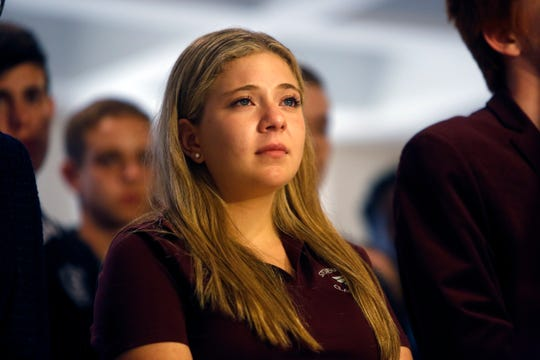 Stoneman Douglas High School Junior Class President Jaclyn Corin's, 17, tears up as she listens to a fellow student tell his story during a news conference at the Capitol in Tallahassee in the days after the Parkland rampage.