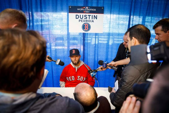 Pedroia speaks to journalists on World Sequence media day in October.