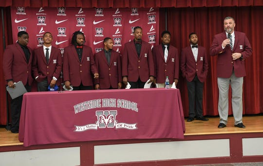 Seven athletes from Westside High School athletes signed a National Letter of Intent to play for colleges or university teams. From left; Newberry College signee Zach Howard, Presbyterian College signees Paul Johnson, Newberry College signee Devante Gambrell, Presbyterian College signee Tim Johnson, Florida Intstitute of Technology signee Ty Ty Danzy, Wingate University signee Nasir Evans, K.D. Fant-Miles, and coach Scott Early.