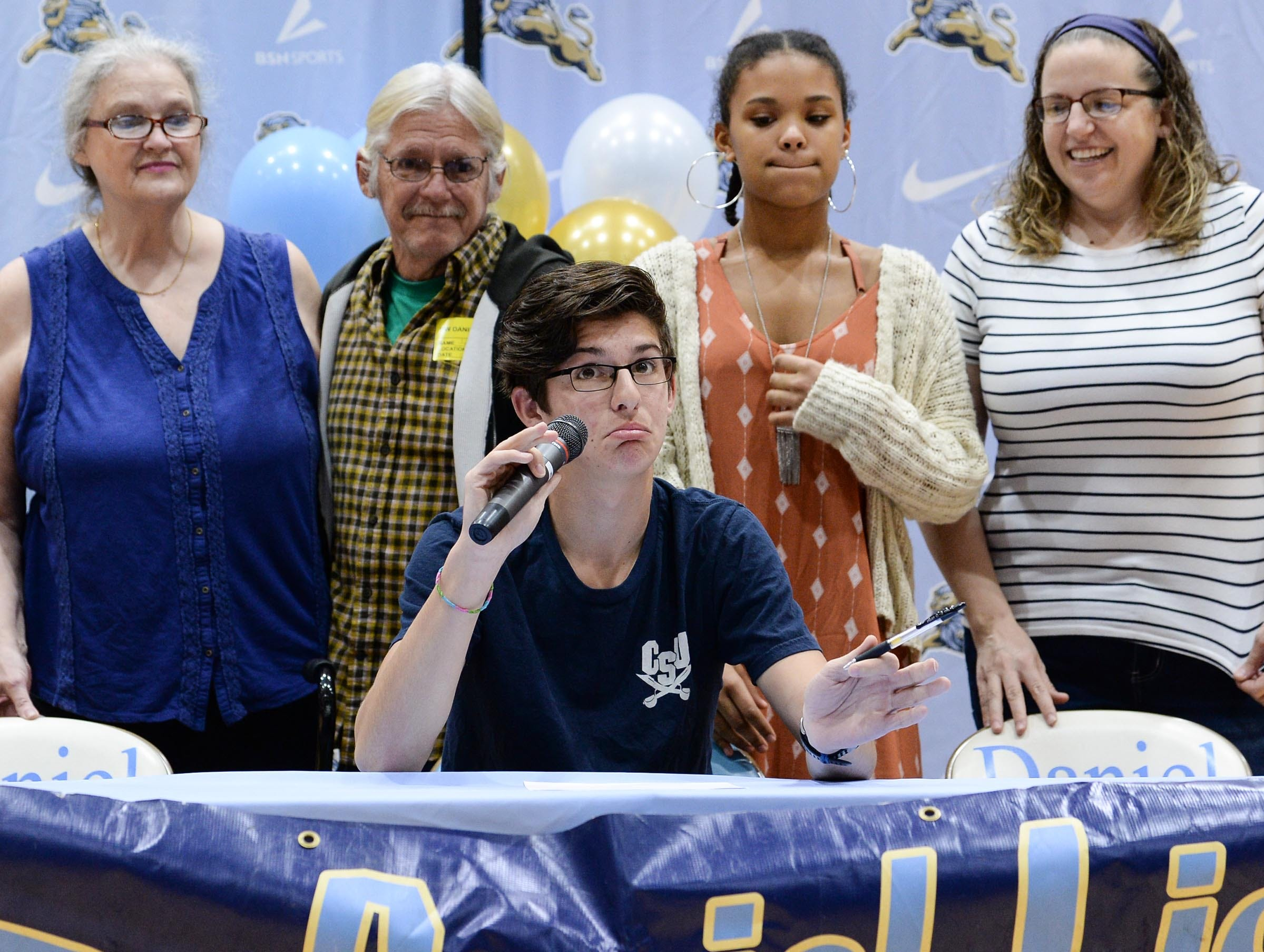 Charleston Southern University cross country signee Alex Zangara makes a speech during National Letter of Intent signing day at D.W. Daniel High School in Central Wednesday.