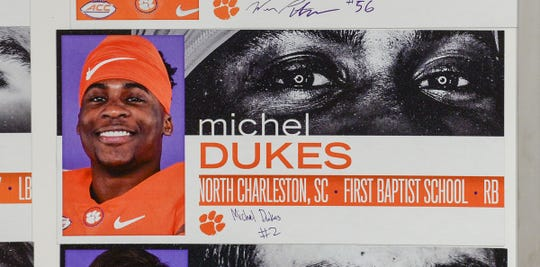 A photo of Michel Dukes, a running back from North Charleston, S.C. First Baptist School, is displayed in the team meeting room for a National Letter of Intent signing day press conference in Clemson Wednesday.