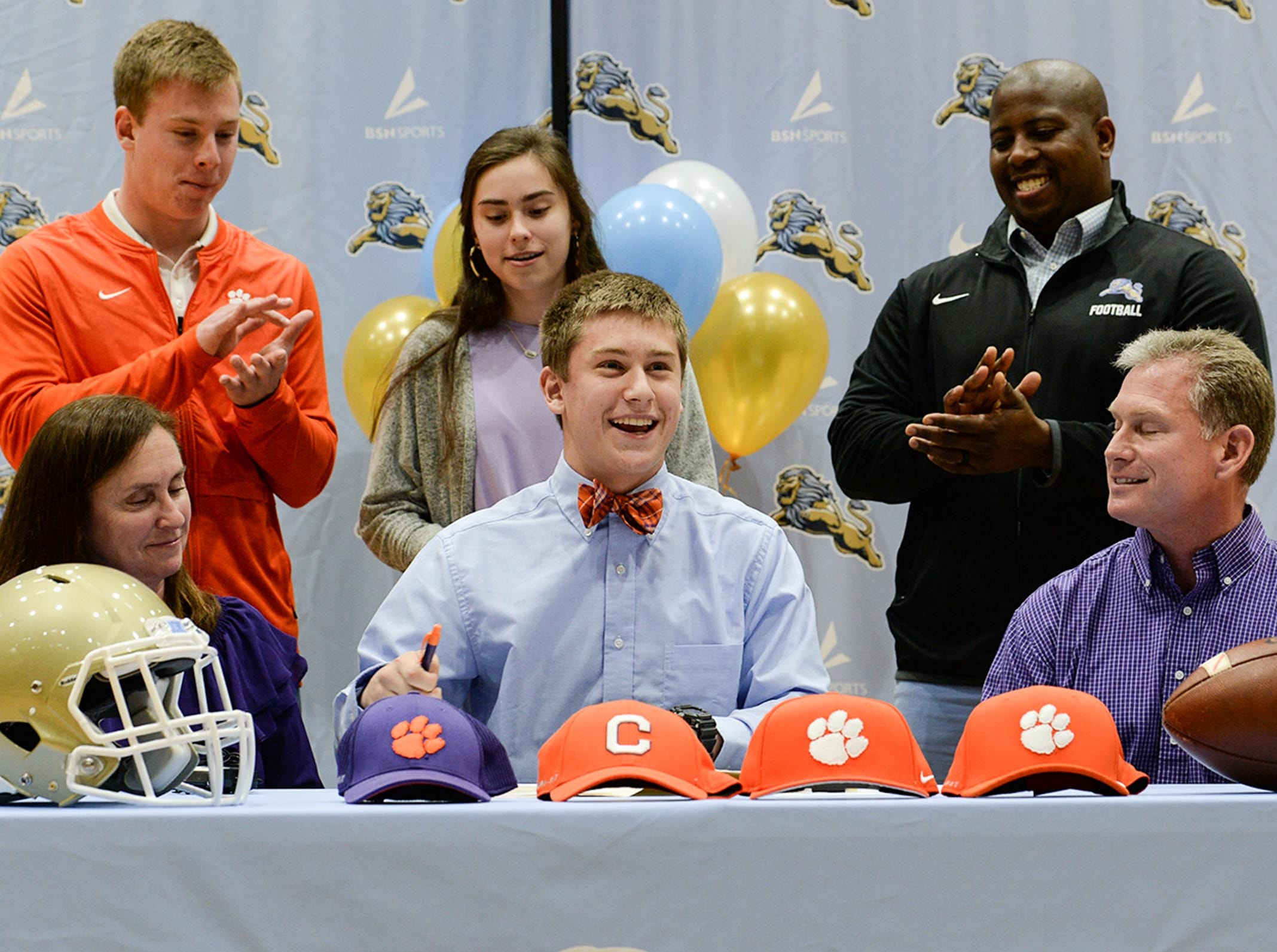 Clemson University football preferred walk on signee Matthew Maloney with parents Phillip and Tina, brother Jacob, sister Jessica, and D.W. Daniel football coach Jeff Fruster, right, during National Letter of Intent signing day at D.W. Daniel High School in Central Wednesday.