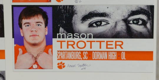 A photo of Mason Trotter, an offensive lineman from Dorman High School in Spartanburg, is displayed in the team meeting room for a National Letter of Intent signing day press conference in Clemson Wednesday.