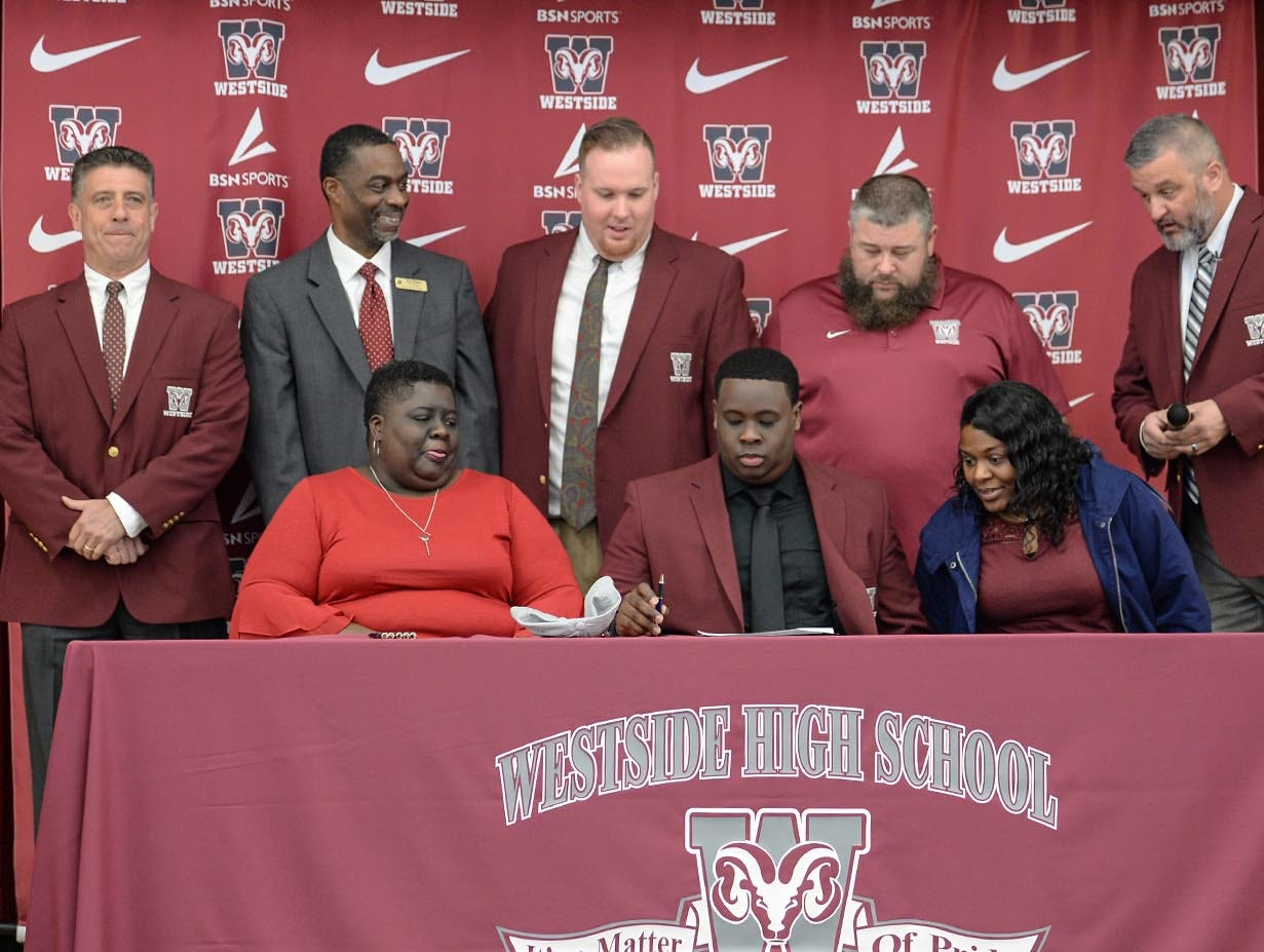 Newberry College signee Zach Howard, one of eight athletes from Westside High School football to sign a National Letter of Intent at Westside High School in Anderson Wednesday. Newberry College signees Zach Howard, Devante Gambrell, Wingate University signees Nasir Evans and K.D. Fant-Miles, Presbyterian College signees Paul Johnson and Tim Johnson, and Florida Intstitute of Technology signee Ty Ty Danzy.
