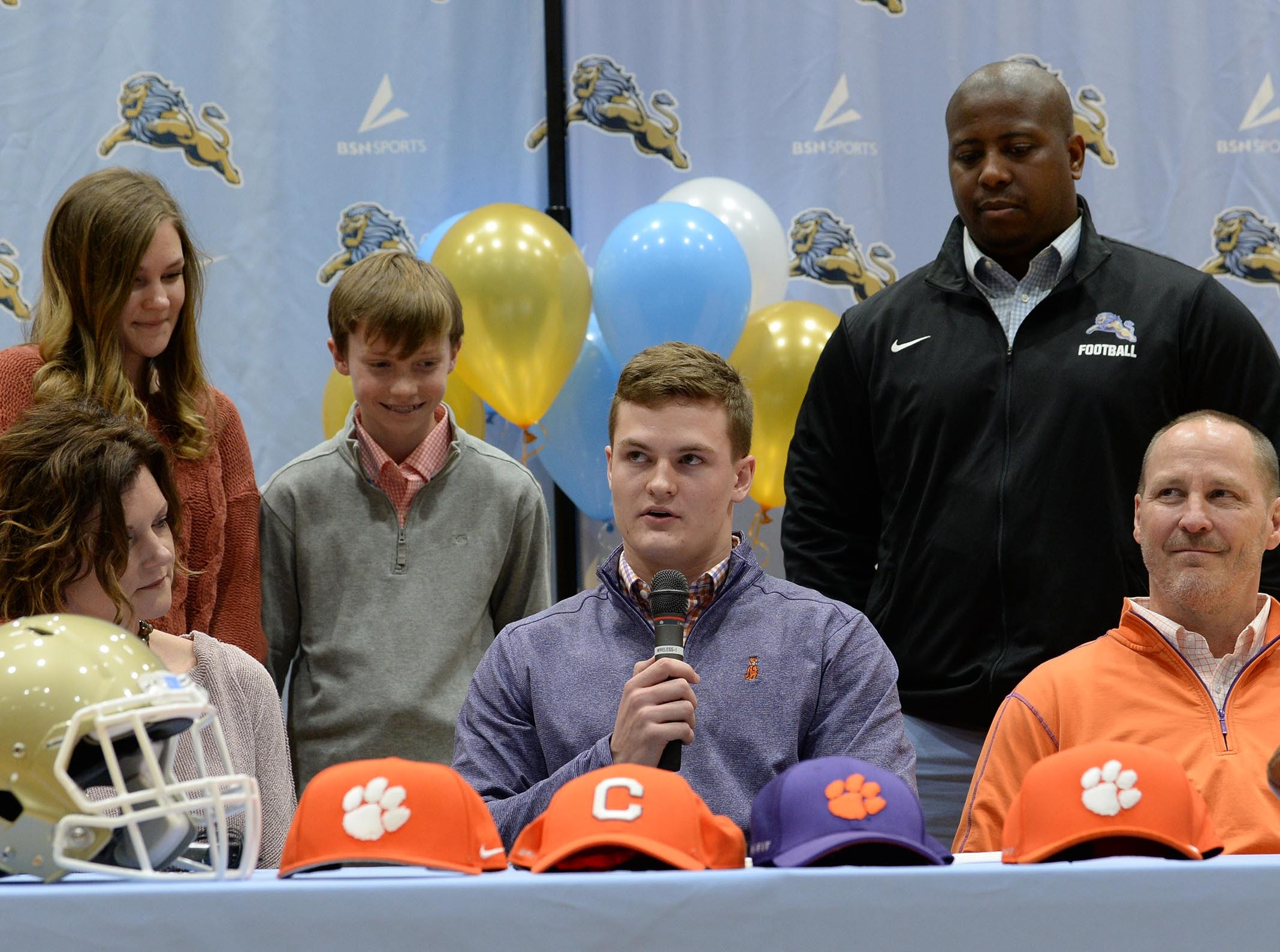 Clemson University football preferred walk on signee Hampton Earle with parents John and Wendy, and D.W. Daniel football coach Jeff Fruster, right, during National Letter of Intent signing day at D.W. Daniel High School in Central Wednesday.