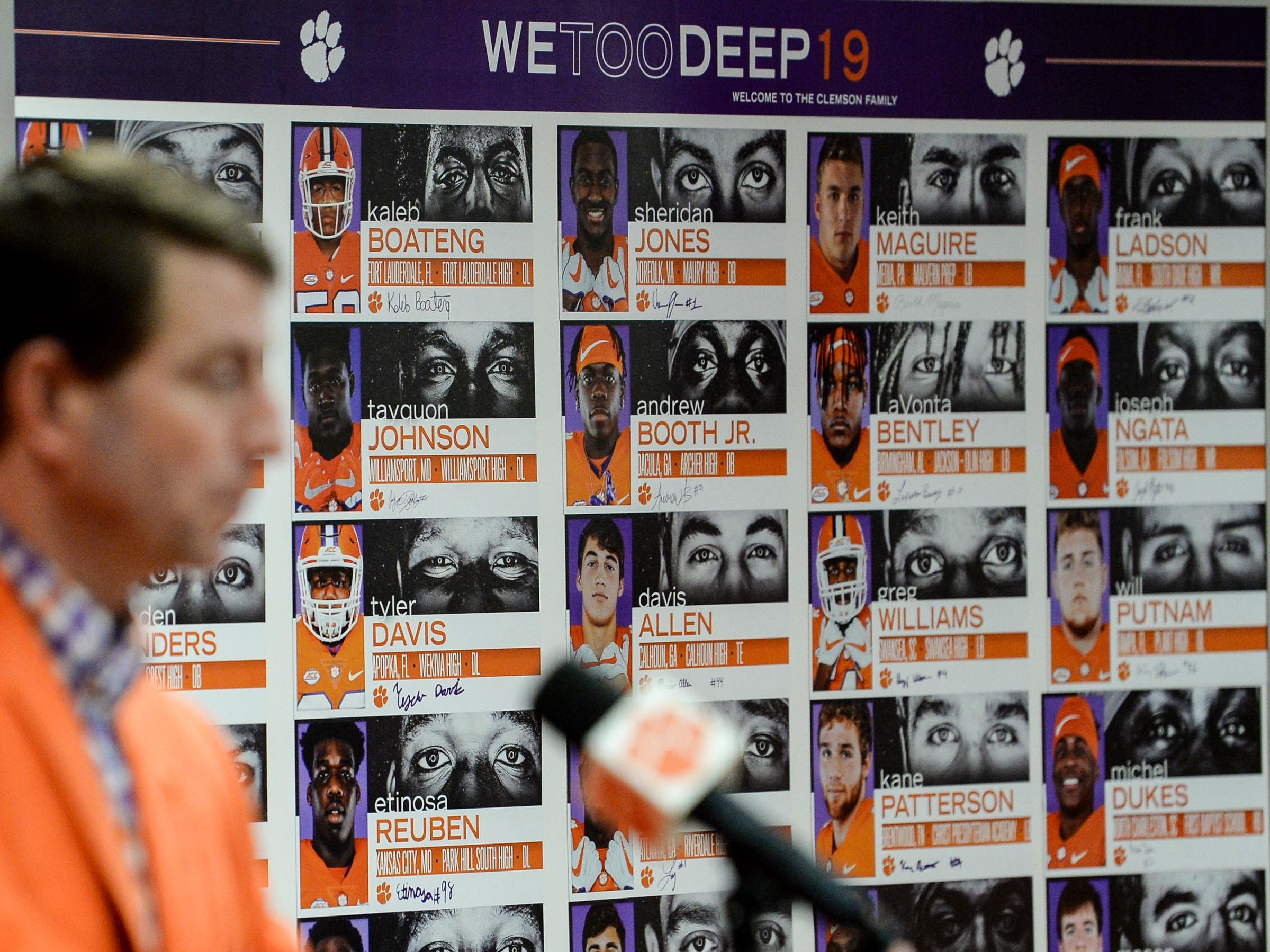 A chart of 29 signees is posted near Clemson head coach Dabo Swinney speaking during National Letter of Intent signing day press conference in Clemson Wednesday.