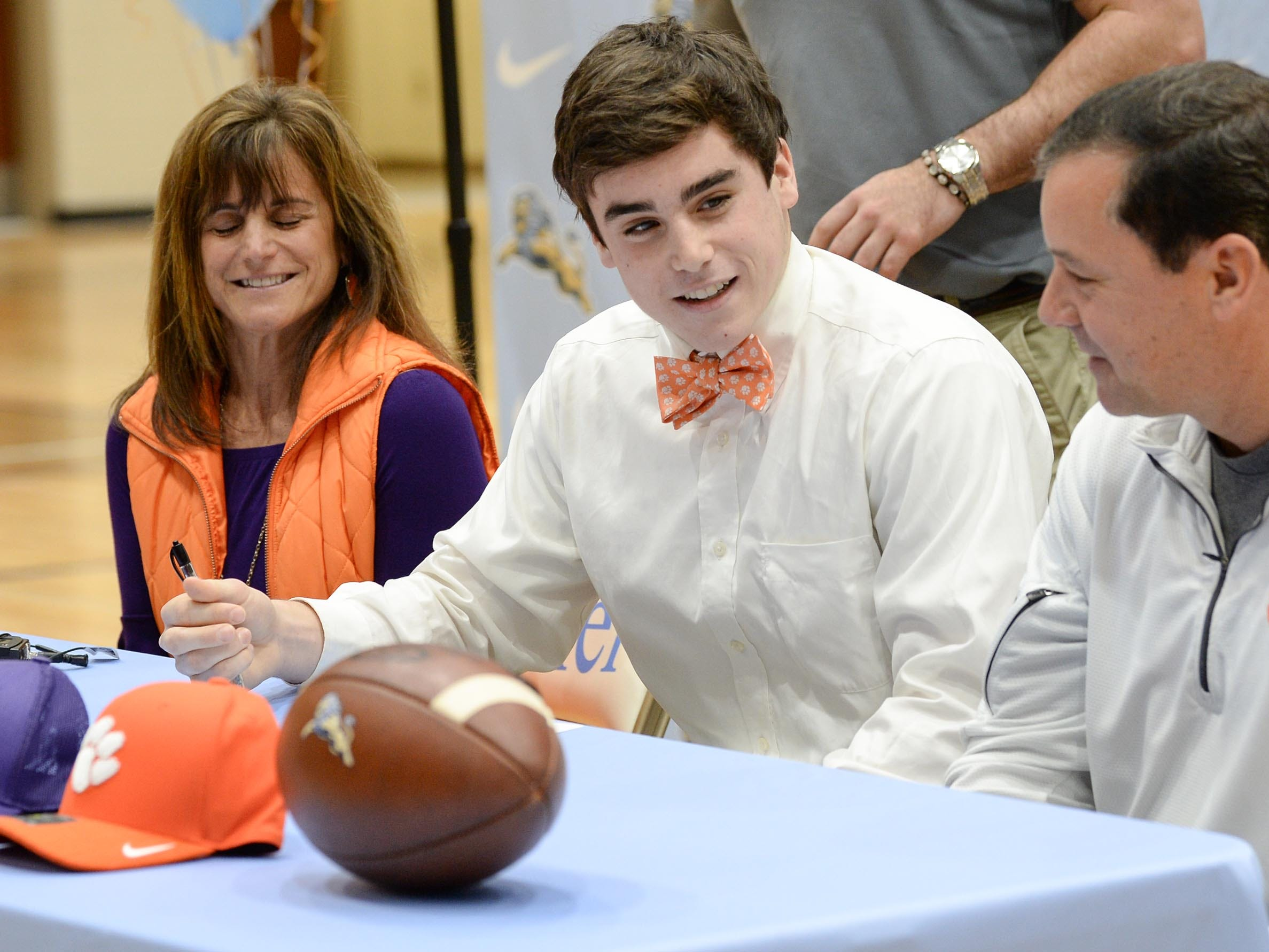 Clemson University football preferred walk on signee David Cote, with parents Marc and Gina during National Letter of Intent signing day at D.W. Daniel High School in Central Wednesday.