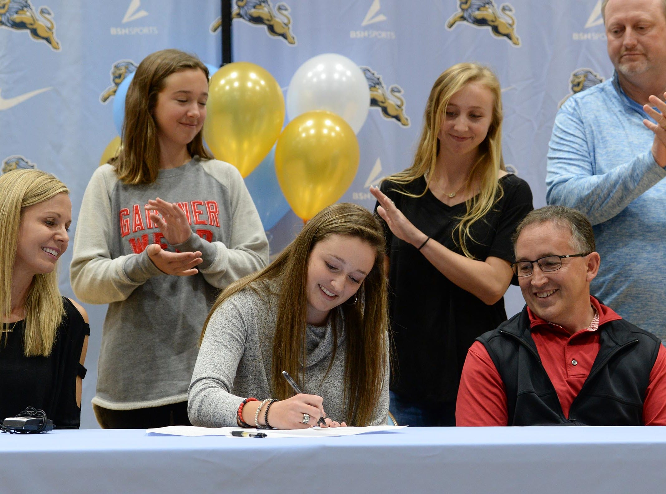 Gardner Webb University golf signee Gillian O'Brien during National Letter of Intent signing day at D.W. Daniel High School in Central Wednesday.