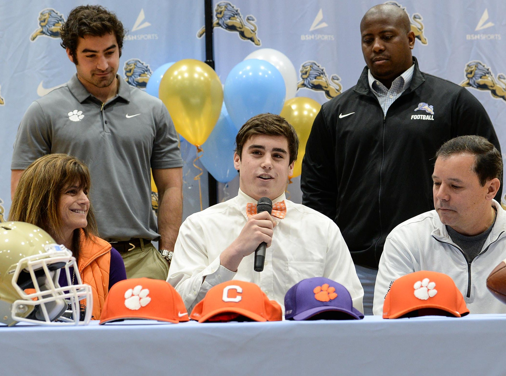 Clemson University football preferred walk on signee David Cote, with parents Marc and Gina with brother Kyle Cote, and D.W. Daniel football coach Jeff Fruster, right, during National Letter of Intent signing day at D.W. Daniel High School in Central Wednesday.