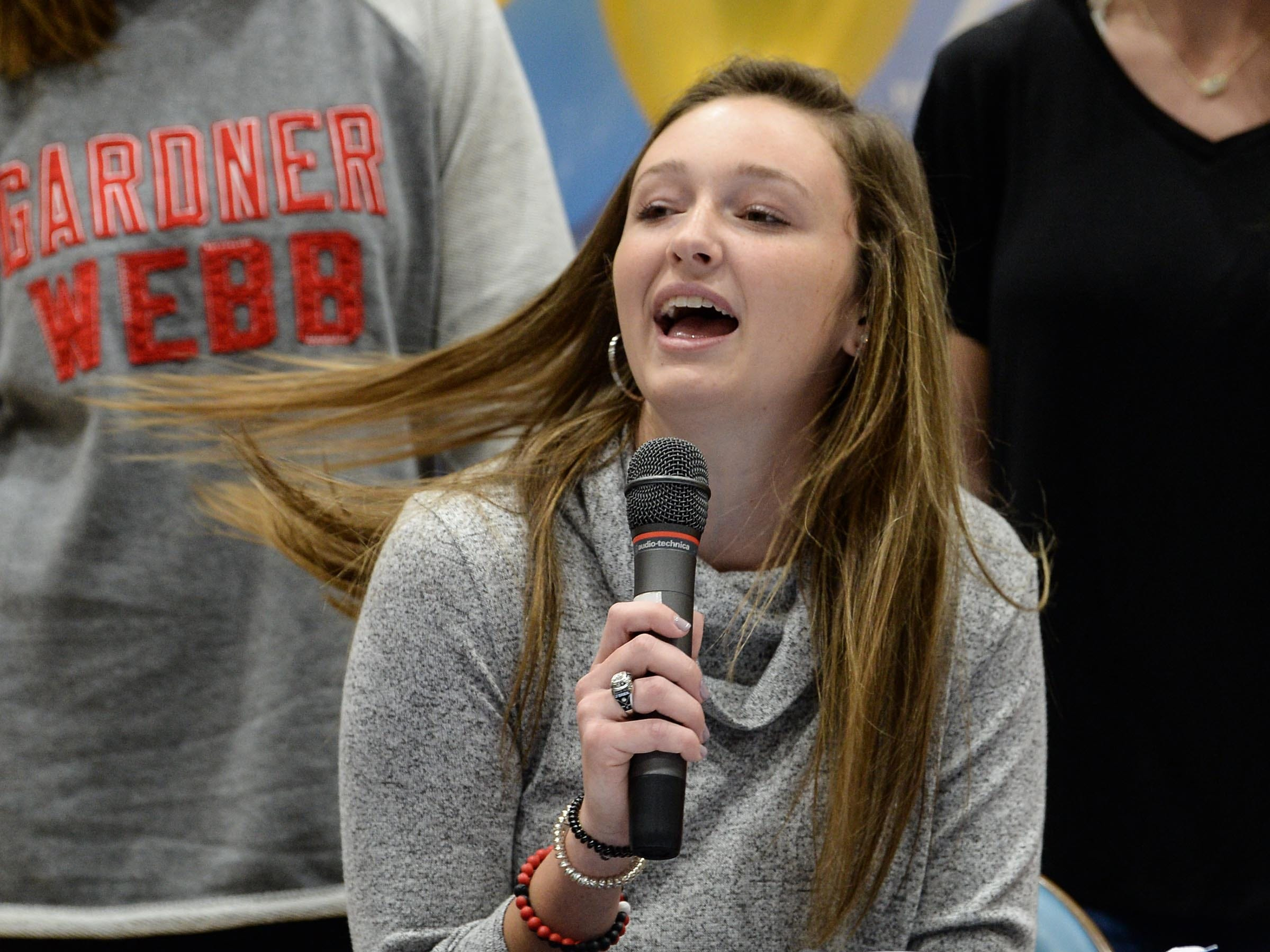 Gardner Webb University golf signee Gillian O'Brien makes a speech during National Letter of Intent signing day at D.W. Daniel High School in Central Wednesday.