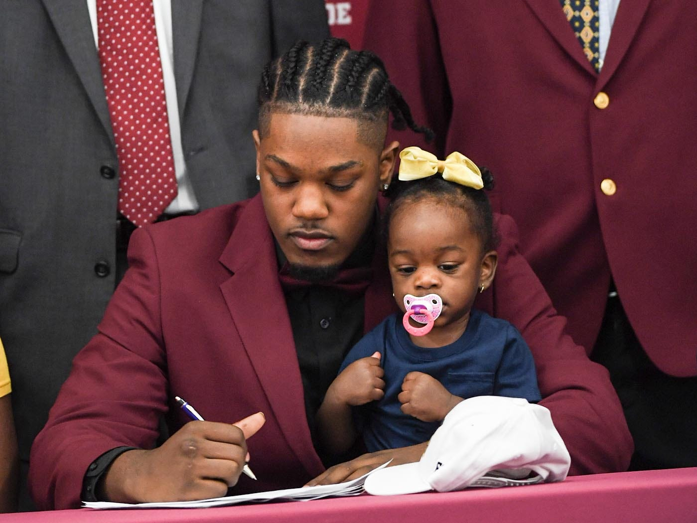 Florida Intstitute of Technology signee Ty Ty Danzy, with little sister True Johnson, is one of seven athletes from Westside High School athletes to sign a National Letter of Intent to play for colleges or university teams.
