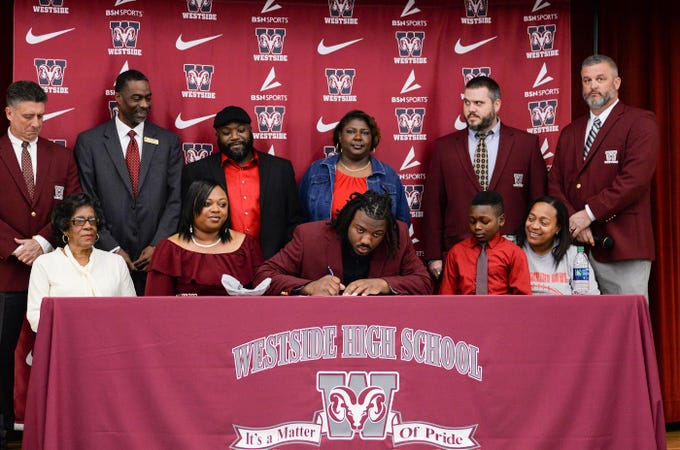 Newberry College signee Devante Gambrell, one of seven athletes from Westside High School football to sign a National Letter of Intent at Westside High School in Anderson Wednesday. Newberry College signees Zach Howard, Devante Gambrell, Wingate University signees Nasir Evans and K.D. Fant-Miles, Presbyterian College signees Paul Johnson and Tim Johnson, and Florida Intstitute of Technology signee Ty Ty Danzy.