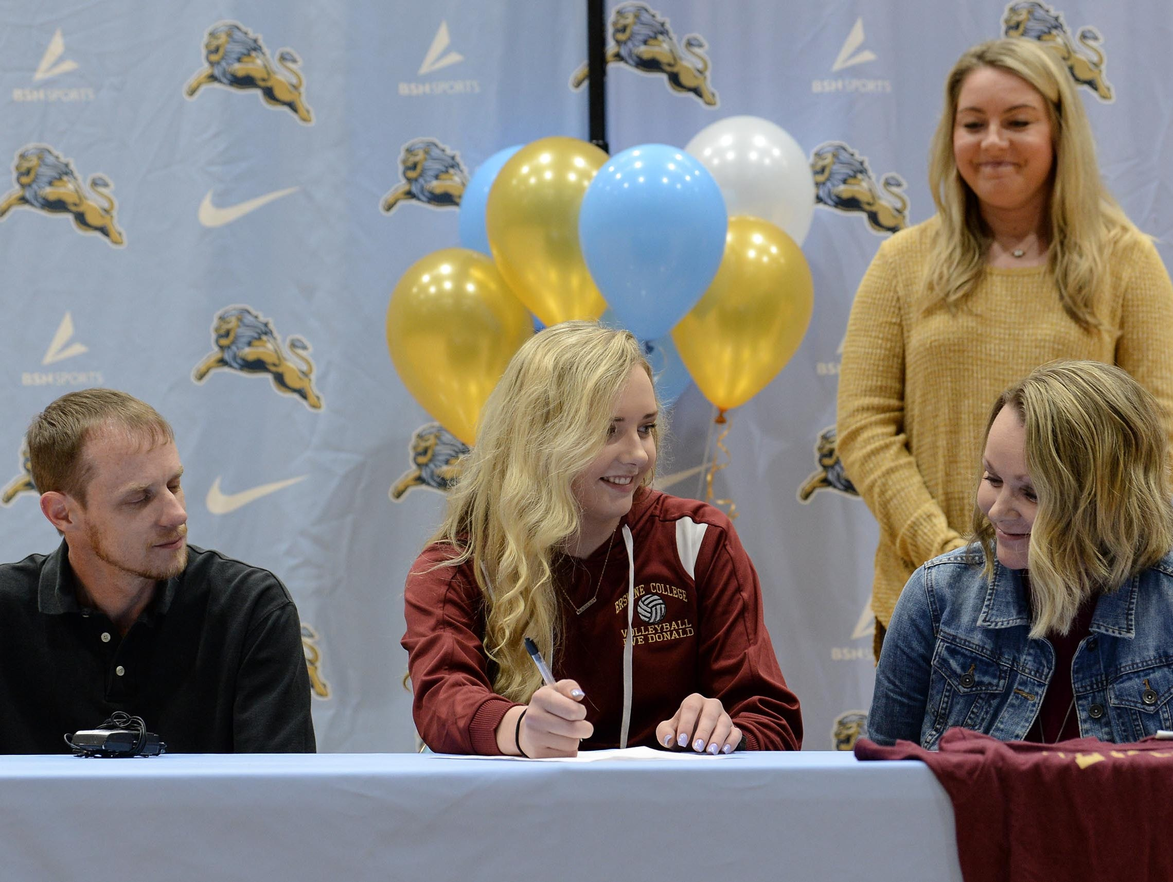 Erskine College volleyball signee Eve Donald, near parents and D.W. Daniel volleyball coach Hayley Hoover during National Letter of Intent signing day at D.W. Daniel High School in Central Wednesday.