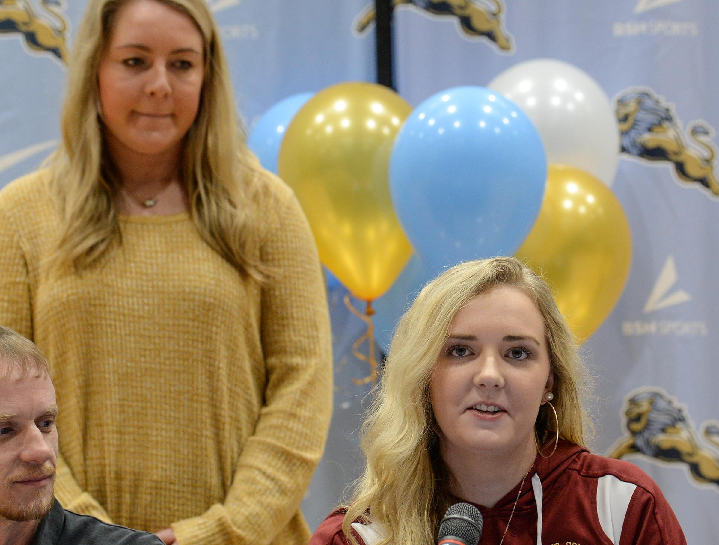 Erskine College volleyball signee Eve Donald speaks near D.W. Daniel volleyball coach Hayley Hoover during National Letter of Intent signing day at D.W. Daniel High School in Central Wednesday.