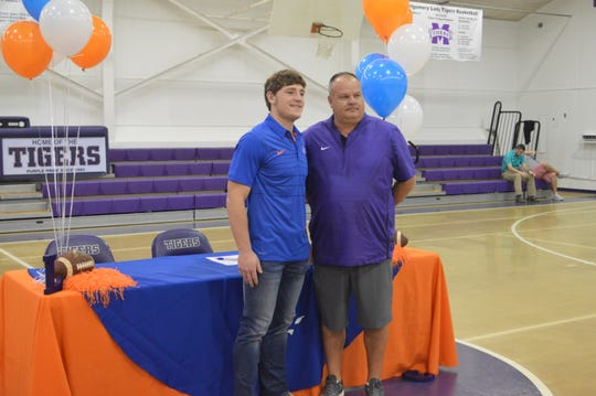 Montgomery linebacker Kason Lashley (left) signed with Louisiana College Wednesday. Lashley poses with his coach, Brian Williams.