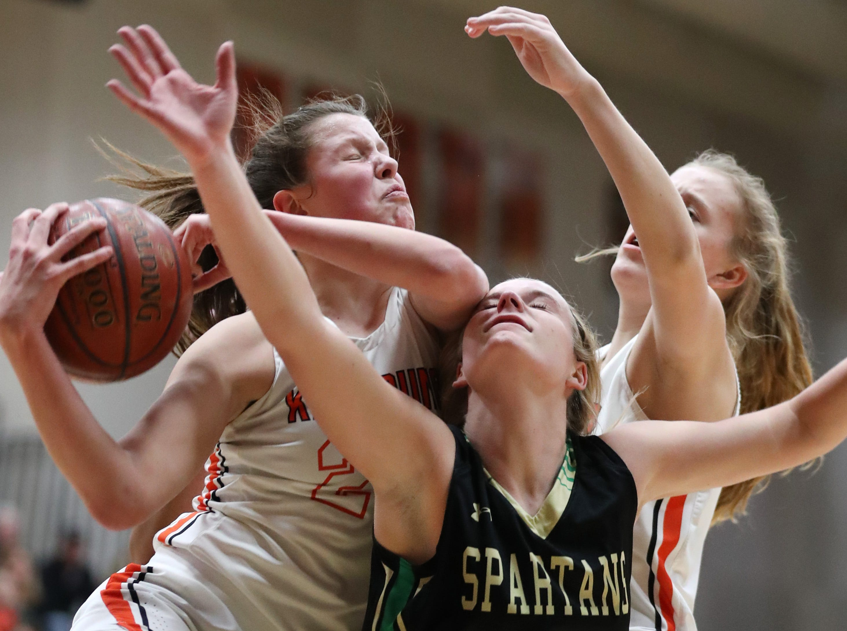 Kaukauna High School's Avery Torrey and Aspen Novy try to get a rebound away from Oshkosh North High SchoolÕs Ashley Wissink Tuesday, Feb. 5, 2019, in Kaukauna, Wis. Oshkosh North defeated Kaukauna High School 77-51.