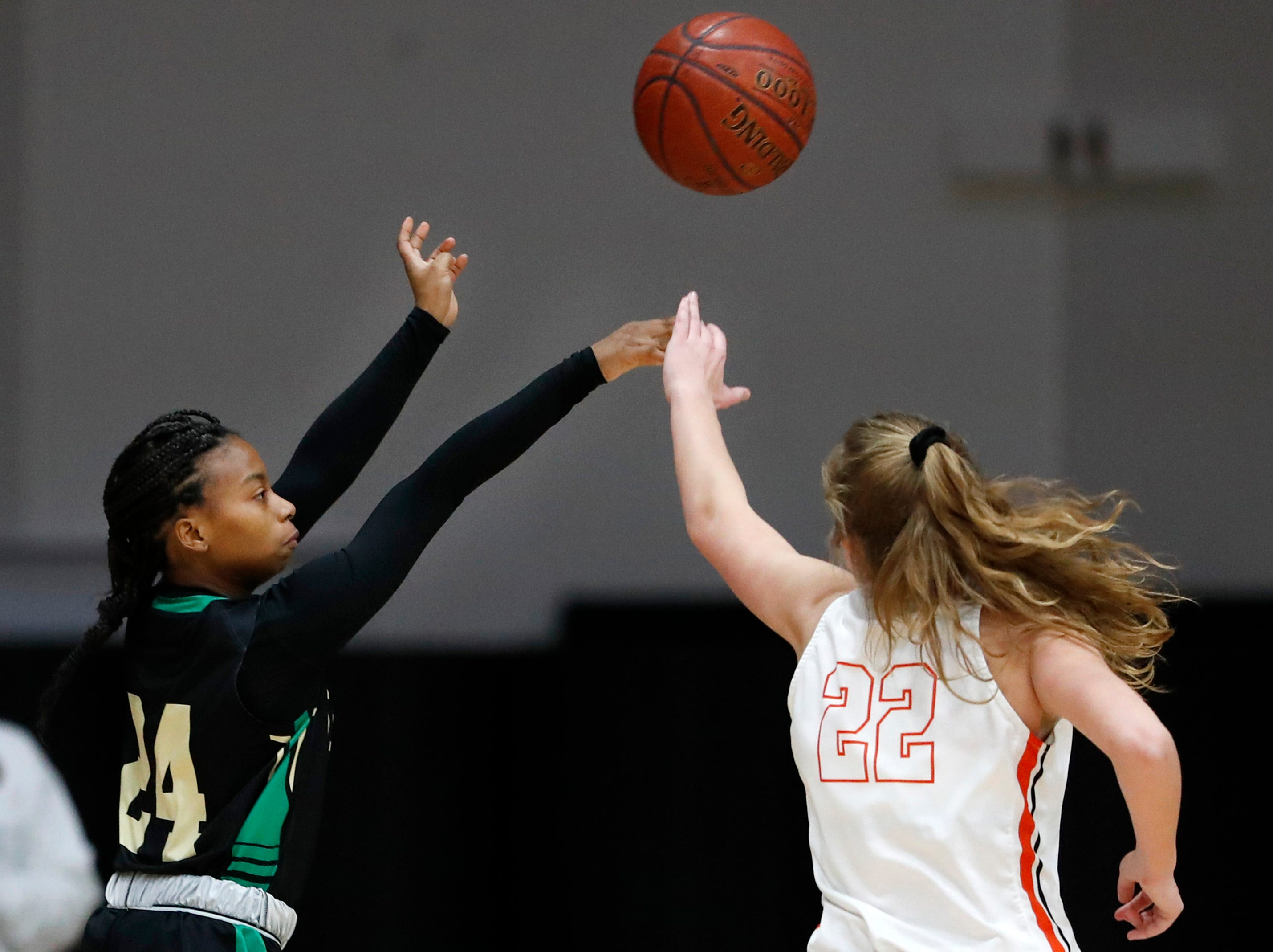 Oshkosh North High SchoolÕs Nydia Griffin gets a shot past Kaukauna High School's Aspen Novy Tuesday, Feb. 5, 2019, in Kaukauna, Wis.