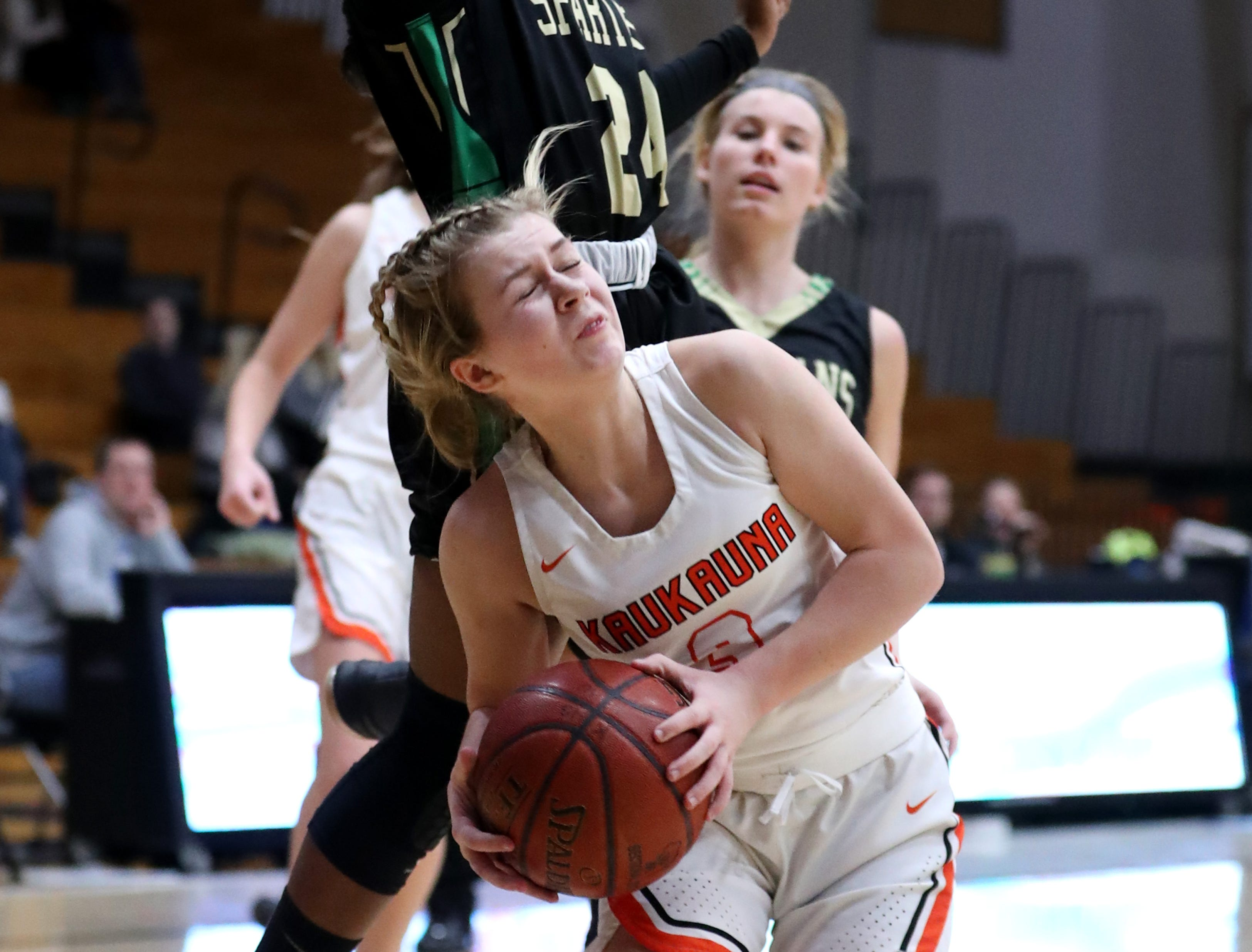 Oshkosh North High SchoolÕs Nydia Griffin fouls Kaukauna High School's Khloe Hinkens Tuesday, Feb. 5, 2019, in Kaukauna, Wis. Oshkosh North defeated Kaukauna High School 77-51.