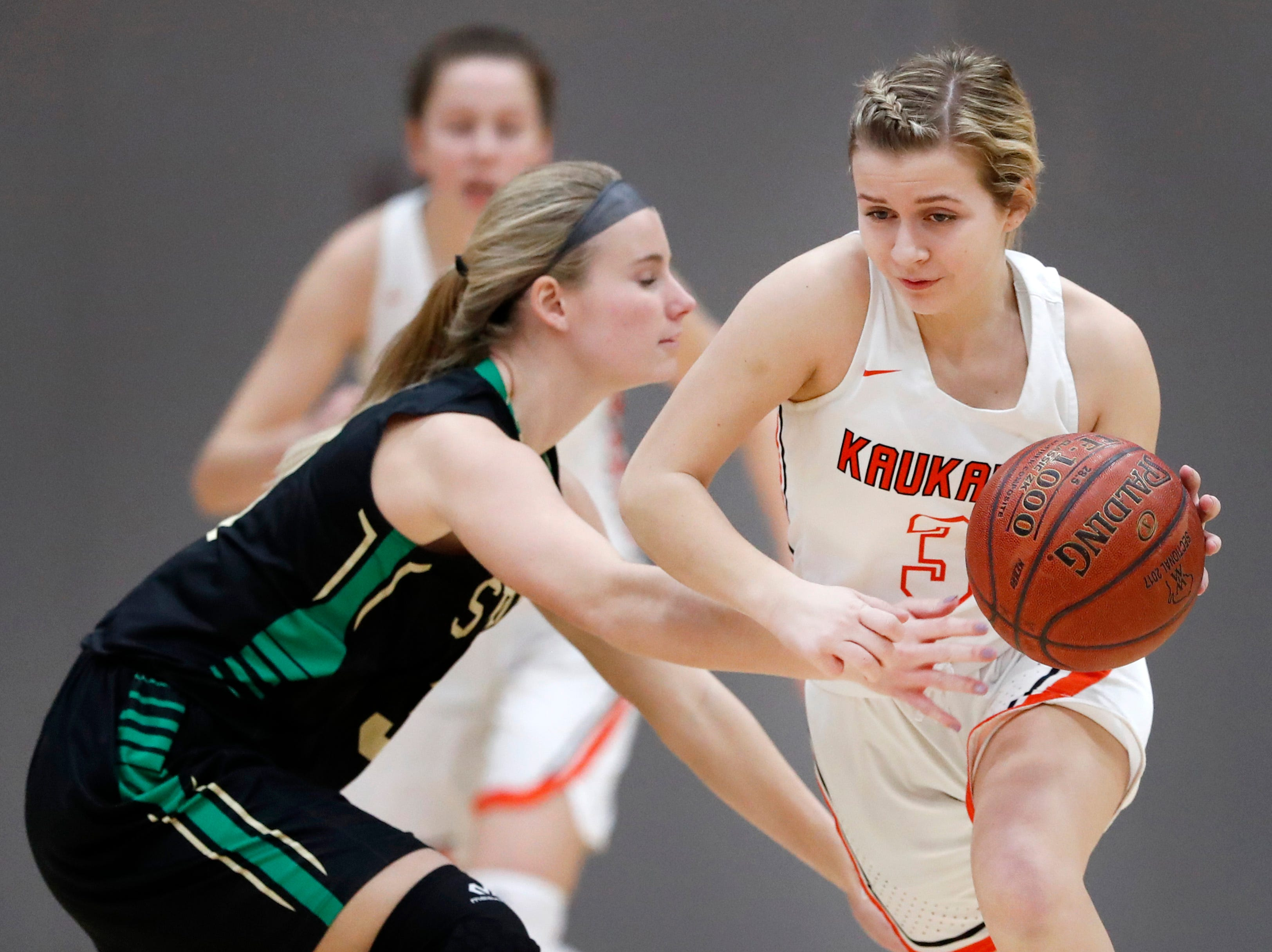 Oshkosh North High SchoolÕs Ashley Wissink tries to stop Kaukauna High School's Khloe Hinkens as she makes a run down the court Tuesday, Feb. 5, 2019, in Kaukauna, Wis. Oshkosh North defeated Kaukauna High School 77-51.