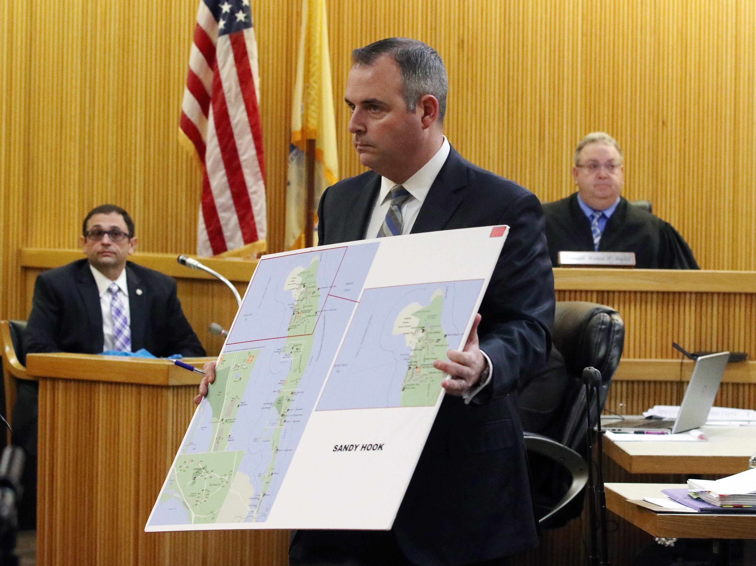 Christopher Decker, assistant Monmouth County prosecutor, shows a map of Sandy Hook to the jury as Detective Nicholas Cattelona of the Monmouth County Prosecutor's Office, testifies during the trial of Liam McAtasney, who is charged with the murder of former high school classmate, Sarah Stern, before Superior Court Judge Richard W. English at the Monmouth County Courthouse in Freehold, NJ Wednesday, February 6, 2019.