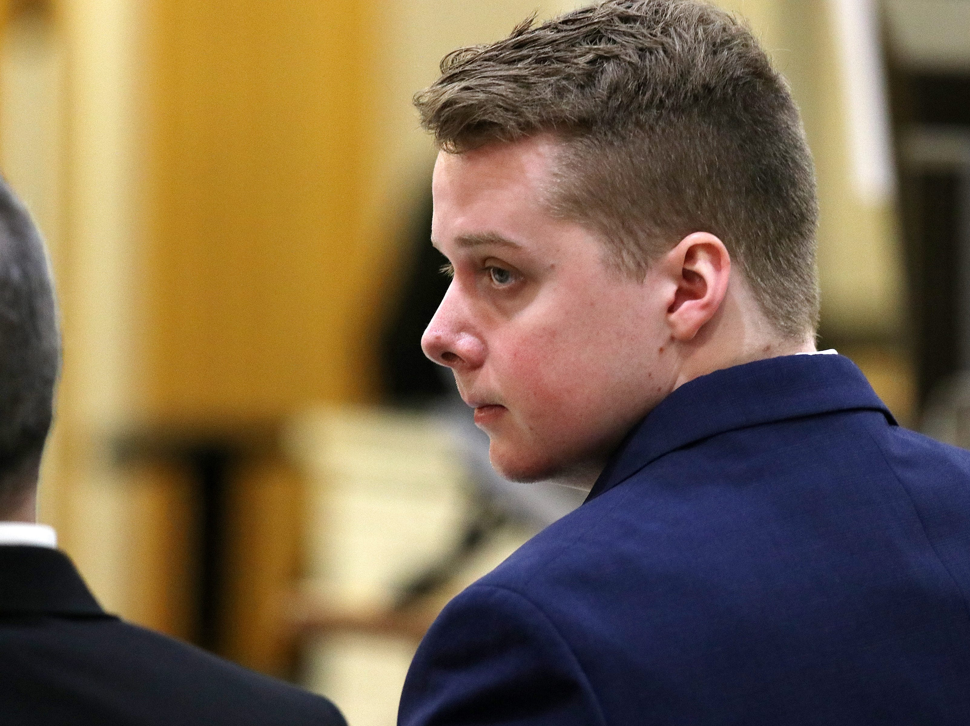 Liam McAtasney, who is charged with the murder of former high school classmate, Sarah Stern, looks at the jury during trial before Superior Court Judge Richard W. English at the Monmouth County Courthouse in Freehold, NJ Wednesday, February 6, 2019.