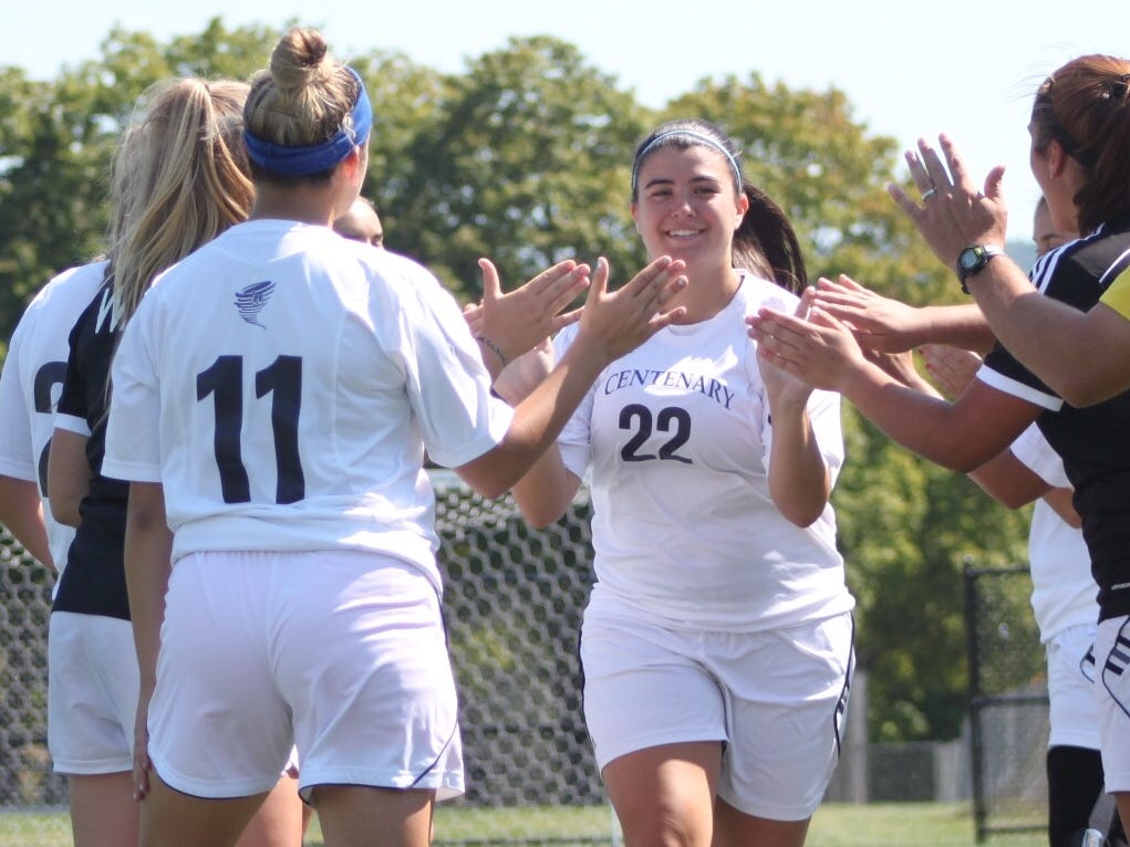 Toms River native Sam Bombardiere, who returned to star at Centenary University after battling ovarian cancer, is greeted by her tammates prior to a game last season.