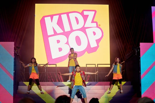 A Kidz Bop performance from a 2019 tour is pictured in this promotional image.