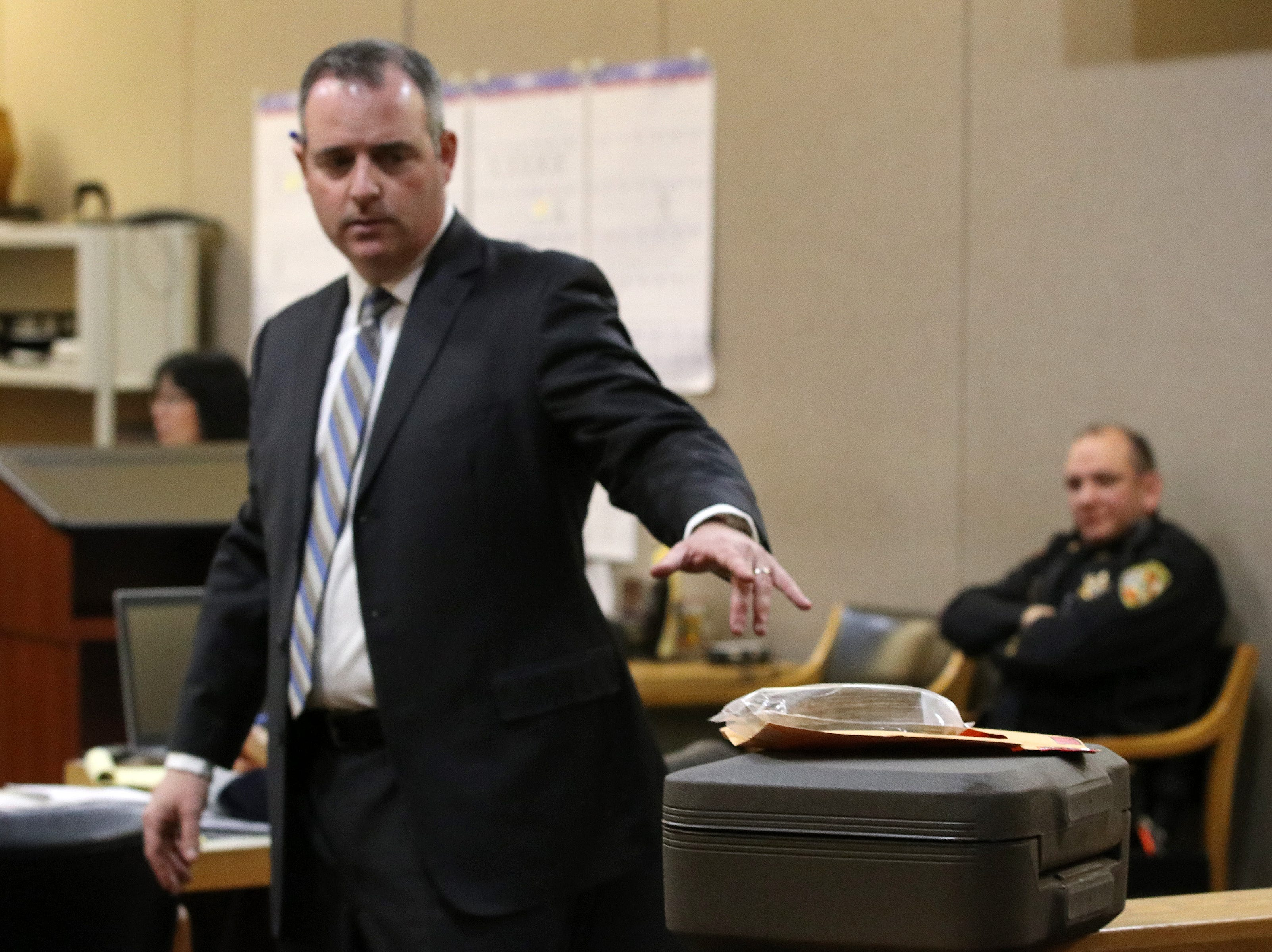 Christopher Decker, assistant Monmouth County prosecutor, presents a safe and cash found inside in Sandy Hook as evidence during the trial of Liam McAtasney, who is charged with the murder of former high school classmate, Sarah Stern, before Superior Court Judge Richard W. English at the Monmouth County Courthouse in Freehold, NJ Wednesday, February 6, 2019.