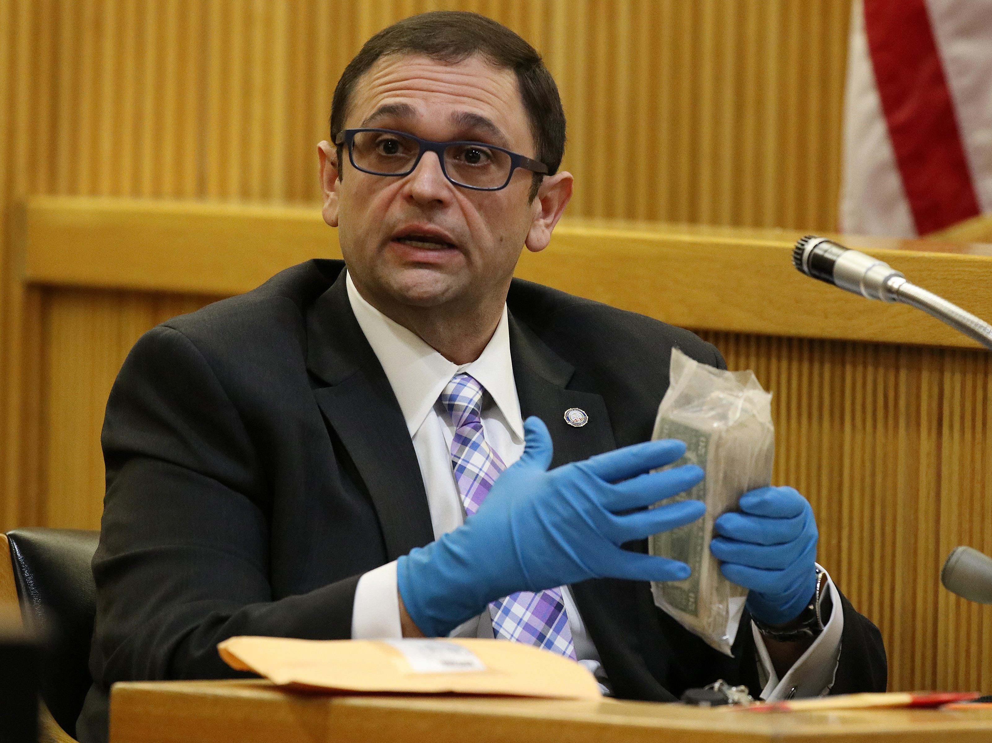 Detective Nicholas Cattelona of the Monmouth County Prosecutor's Office, identifies money found in a safe in Sandy Hook as he testifies during the trial of Liam McAtasney, who is charged with the murder of former high school classmate, Sarah Stern, before Superior Court Judge Richard W. English at the Monmouth County Courthouse in Freehold, NJ Wednesday, February 6, 2019.