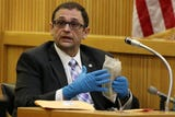 Monmouth County Prosecutors office Detective Nicholas Cattelona testifies about money found inside safe.