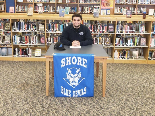 Shore Regional Senior lineman, Vincenzo DiMaio, who signed his National Letter of Intent to play football at Assumption College.