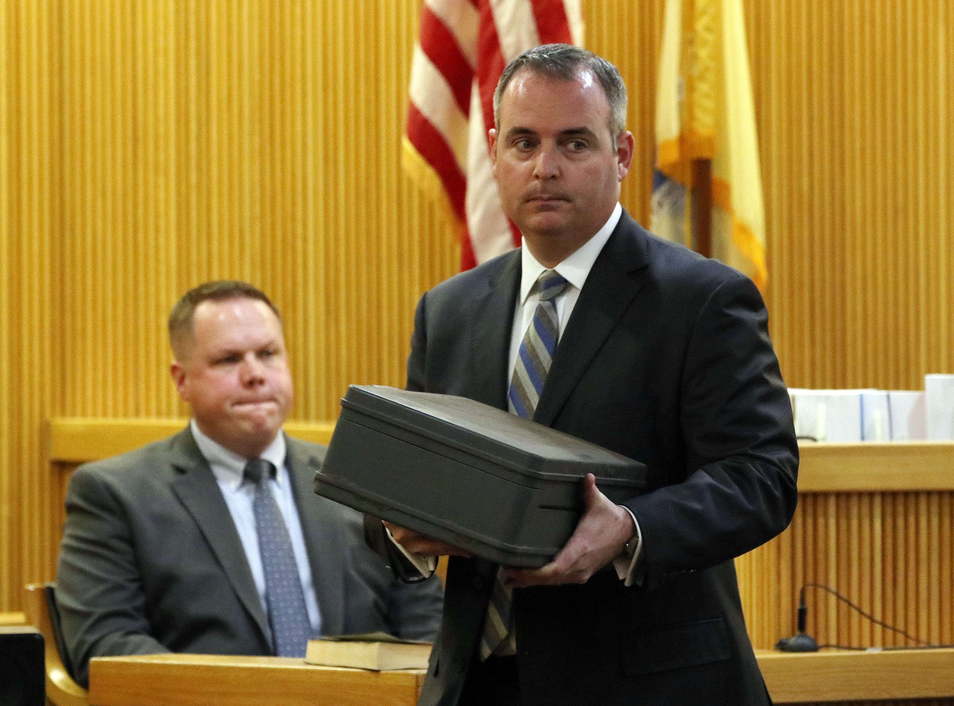 Christopher Decker, Monmouth County assistant prosecutor, asks Detective SGT Ryan Muller of the Monmouth County Prosecutor's Office, to identify Sarah Stern's safe, which was found in Shark River Park, as he testifies during the trial of Liam McAtasney, who is charged with the murder of former high school classmate, Sarah Stern, before Superior Court Judge Richard W. English at the Monmouth County Courthouse in Freehold, NJ Wednesday, February 6, 2019.