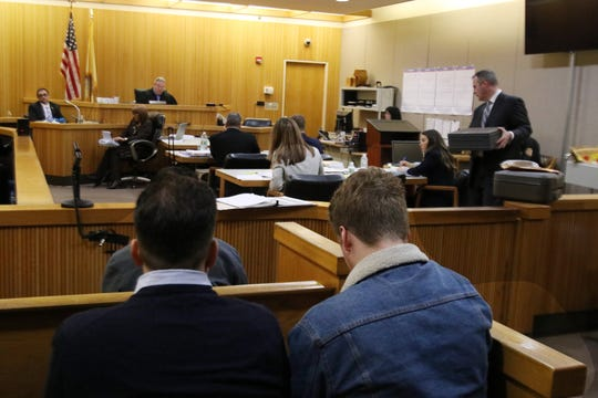 Quinn McAtasney, father of Liam McAtasney, and Seamus McAtasney, twin brother of Liam McAtasney, watch from the gallery as Detective Nicholas Cattelona of the Monmouth County Prosecutor's Office, testifies during the trial of Liam McAtasney, who is charged with the murder of former high school classmate, Sarah Stern, before Superior Court Judge Richard W. English at the Monmouth County Courthouse in Freehold, NJ Wednesday, February 6, 2019.