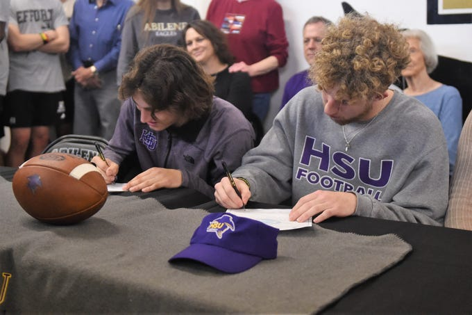Abilene High's Reese Pettijohn, left, and Tyler Simpson make their commitment to Hardin-Simmons on Wednesday, Feb. 6, 2019.