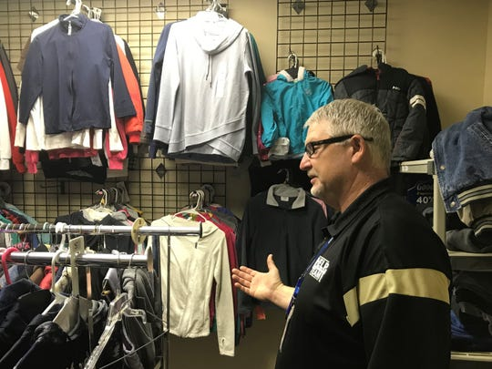 Darrin Cox, homeless liaison for the Abilene Independent School District, shows off a storeroom for clothing items he has set up for distribution to homeless youths. Cox said the community stepped up in the roughly two years since he and the department within AISD administration established the store to help students who classify as homeless under the McKinney-Vento Act.