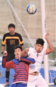 Cooper's John Scaeif, left, battles Stephenville's Isidro Manzano (4) for the ball while Stephenville goalie Alfredo Rocha looks on. Cooper beat the Yellowjackets 4-3 in the nondistrict game Tuesday, Feb. 5, 2019, at Shotwell Stadium.