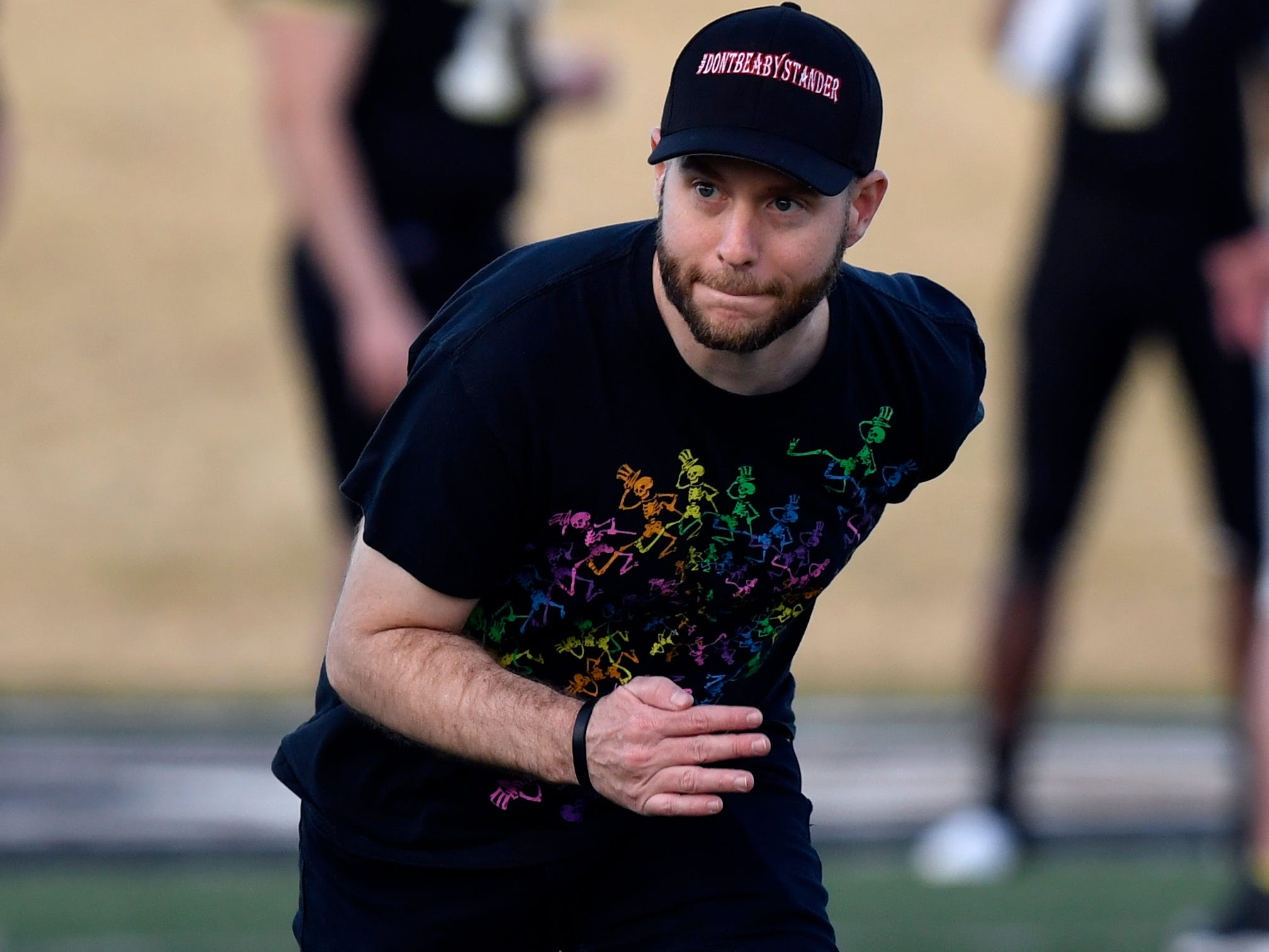 "Director Todd Randall runs downfield at Shotwell Stadium, simulating Herschel Sims' 95-yard touchdown. His sprint was for the benefit of extras in the crowd to have a ""sightline"" for their cheering Saturday Feb. 2, 2019. Randall's film, ""Brother's Keeper"", is the story about the Abilene High School Eagles' 2009 championship season."
