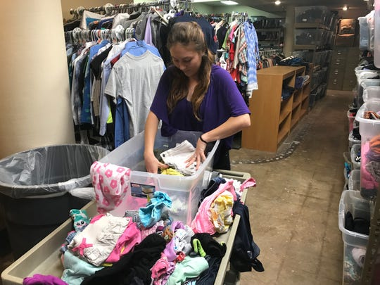 Samantha Pennese, a Hardin-Simmons University senior social work student interning at the Abilene Independent School District, organizes girl undergarments in the district's distribution center in the basement of One AISD Center, 241 Pine St., on Feb. 6. AISD collects the clothing items under a program run by Homeless Liaison Darrin Cox, and distributes the underwear, socks, shirts, pants, shoes and more to those in need at any time of the year.