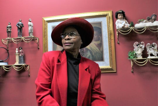 Neomia Banks' State Farm office is adorned with artwork, dolls and figurines.