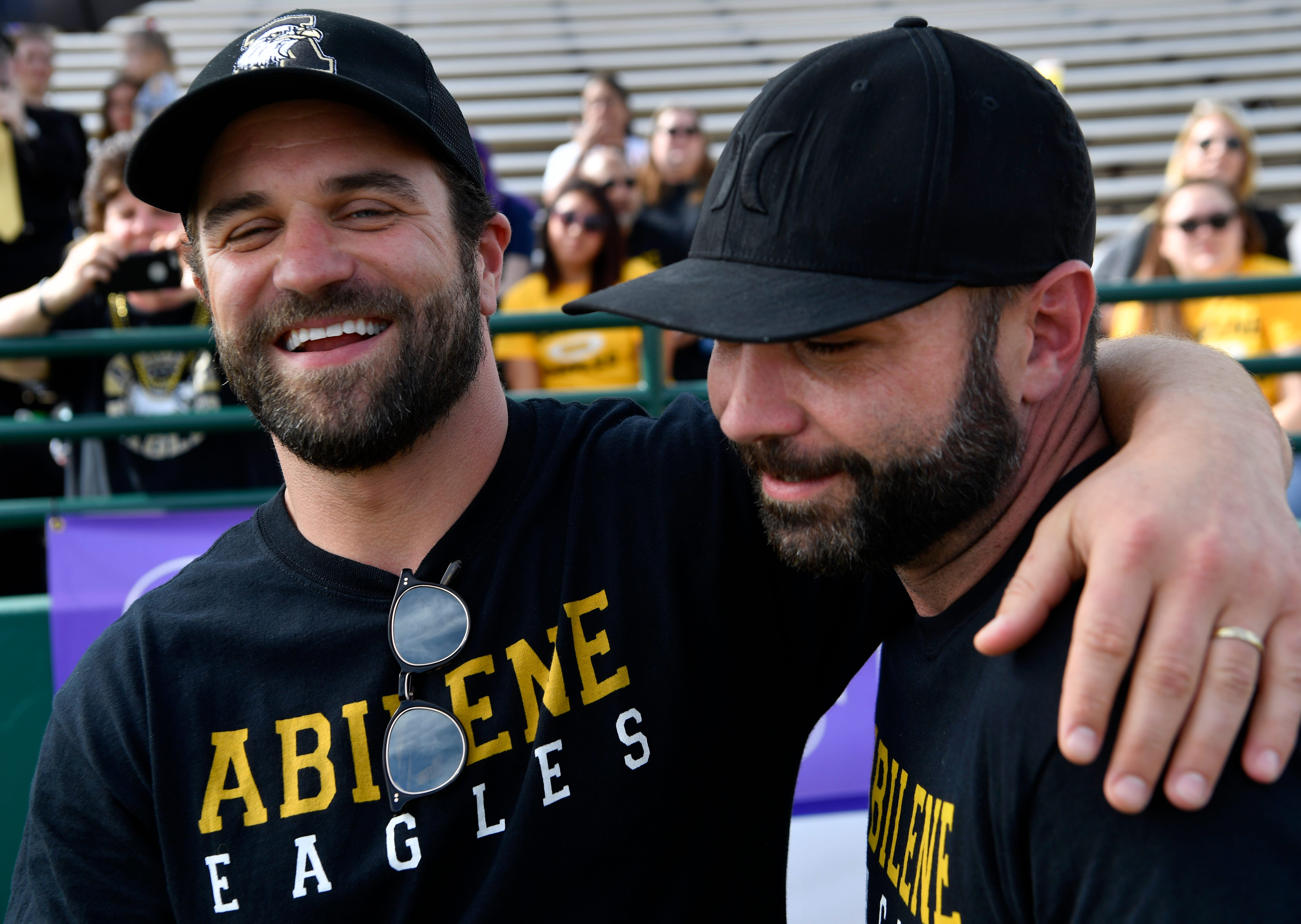 """Milo Gibson puts an arm around Chad Mitchell for a picture during filming Saturday for """"Brother's Keeper"""" at Shotwell Stadium. Gibson plays Mitchell in the film which film recreates the Abilene High School Eagles 2009 championship football season."""