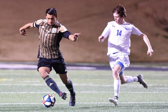 Abilene High's Joseph Martinez (7) turns away from a Weatherford defender on Tuesday, Feb. 5, 2019, at Shotwell Stadium. Martinez scored as the Eagles won 5-0.