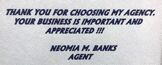 A sign in Neomia Banks' office.