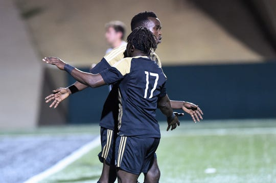 Abilene High's Enock Gasore (9) is congratulated by Ray Mouloungui (17) after scoring a penalty kick against Weatherford at Shotwell Stadium on Tuesday, Feb. 5, 2019. Gasore scored twice and Mouloungui once in the 5-0 win.