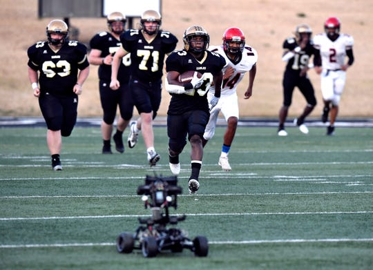 "Acoryé White chases a remote-controlled car carrying a camera as he reenacts  Herschel Sims' 95-yard touchdown run for the film ""Brother's Keeper"" Saturday Feb. 2, 2019. Shotwell Stadium was occupied by the movie crew all weekend as they shot football-action scenes for the upcoming film which depicts the 2009 Abilene High School championship football season."