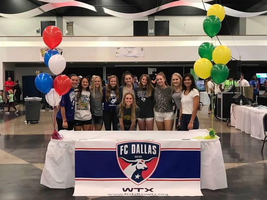 Wylie soccer's Jacqueline Williams, front, stands with her teammates after signing with Missouri Southern State University on Saturday at the West Texas Sports & Fitness Expo.
