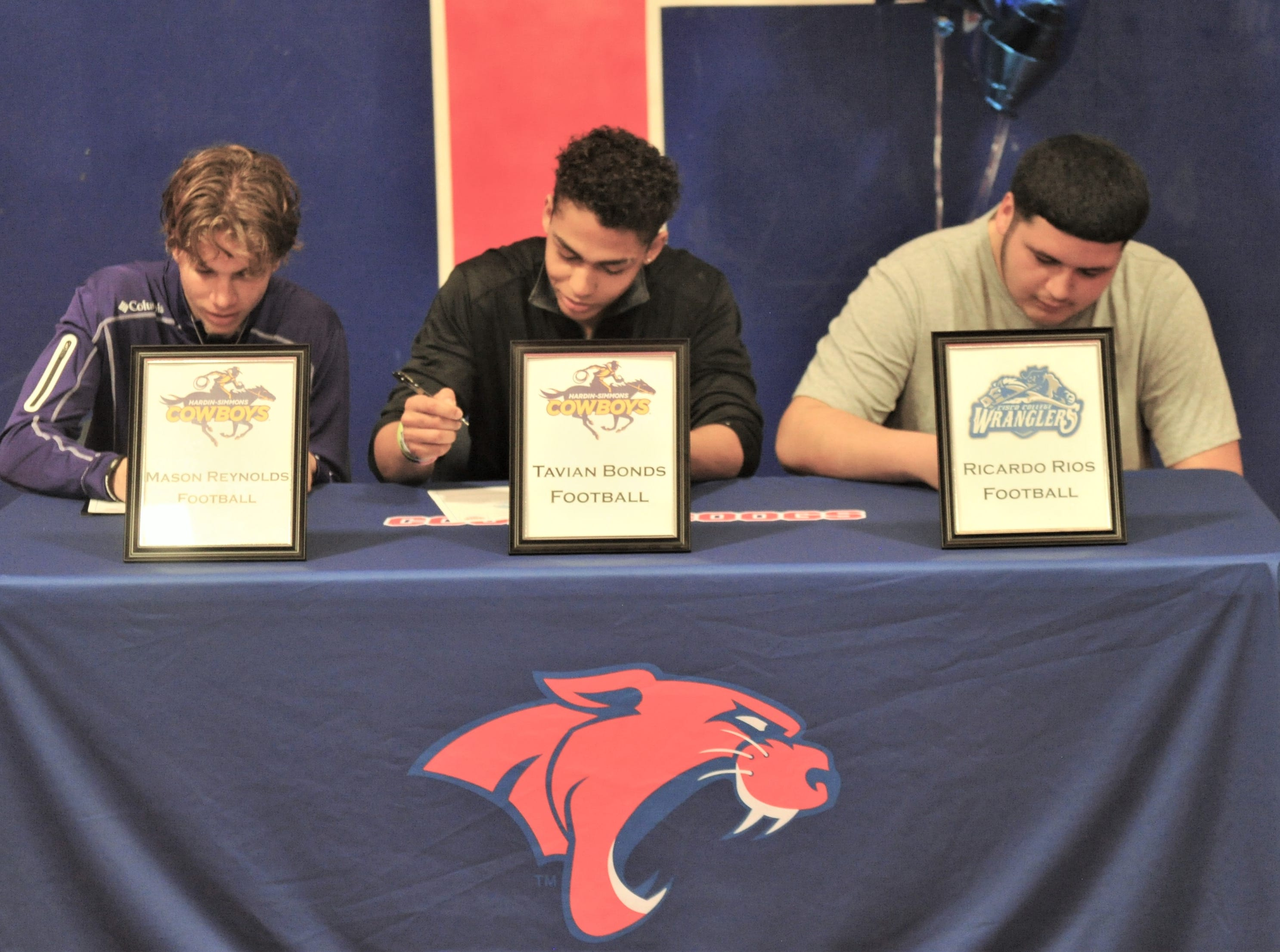Cooper receiver Mason Reynolds, left, linebacker Tavian Bonds, center, and offensive lineman Ricardo Rios were part of a signing ceremony at the Cooper weight room on Wednesday, Feb. 6, 2019. Reynolds and Bonds will play at Hardin-Simmons next season, while Rios will play at Cisco College.