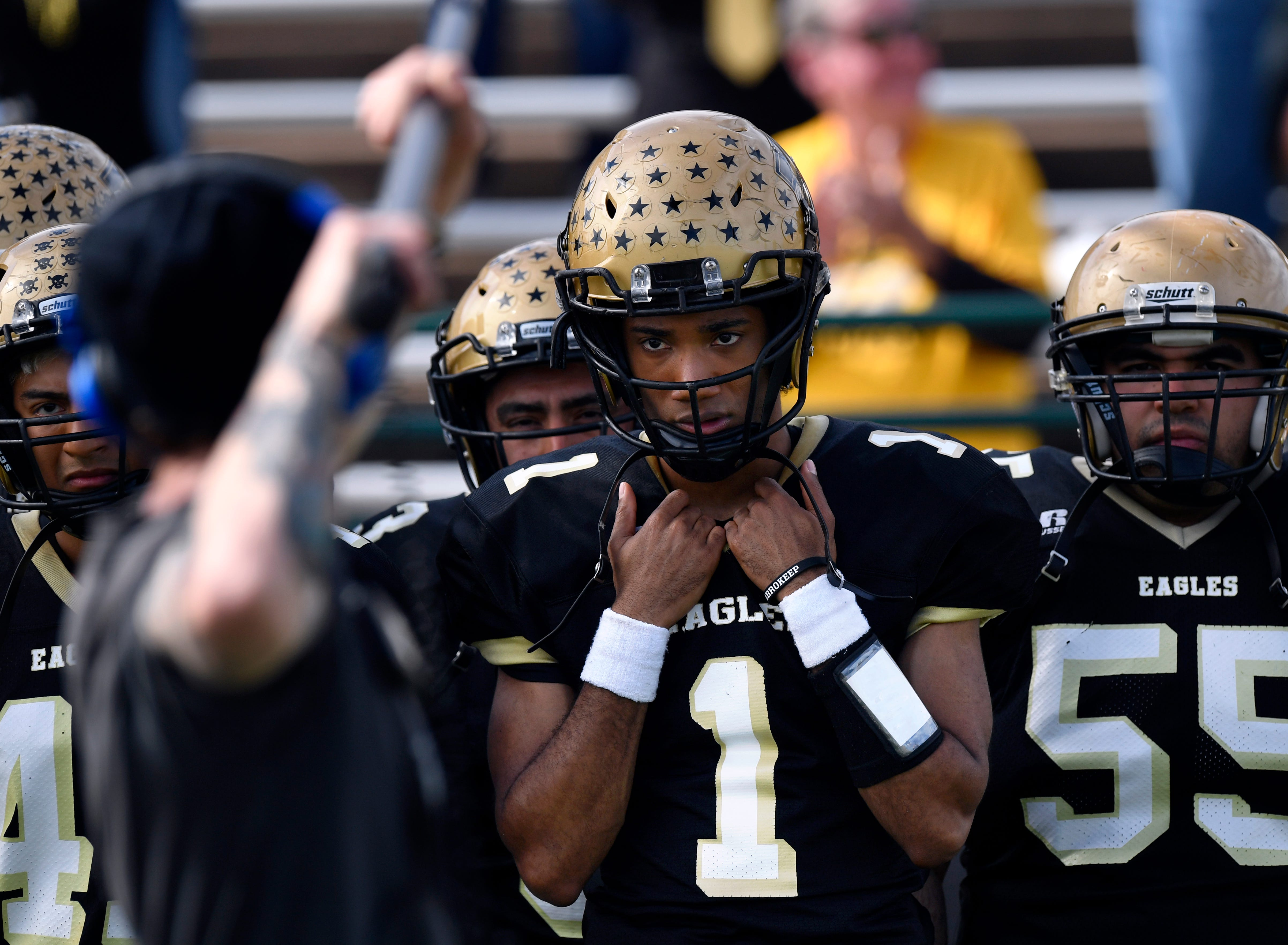 """Carter Redwood, playing Ronnell Sims, performs as an audio technician holds a microphone over his head during filming Monday, Feb. 4, 2019, of """"Brother's Keeper"""" at Shotwell Stadium. The film recreates the Abilene High School Eagles 2009 championship football season."""