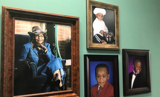 A wall at Neomia's office includes photos of grandchildren and the agent in western motif.