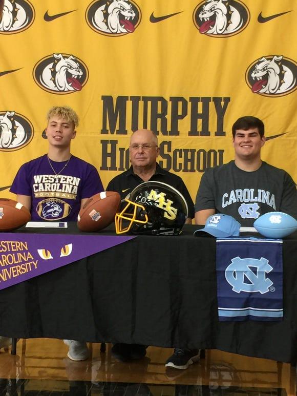 Micah Nelson (left) signed with Western Carolina while Hunter Shope signed with North Carolina.