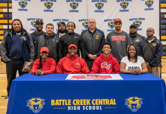 Battle Creek Central's Ke'Ondre Glass and Jermaine Morris are joined by family and the Bearcat coaching staff as they sign to play football at Saginaw Valley State University.